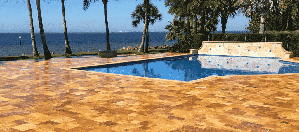 Travertine Slider | Travertine Sealing on Patio and Pool | Peter's Pressure Washing
