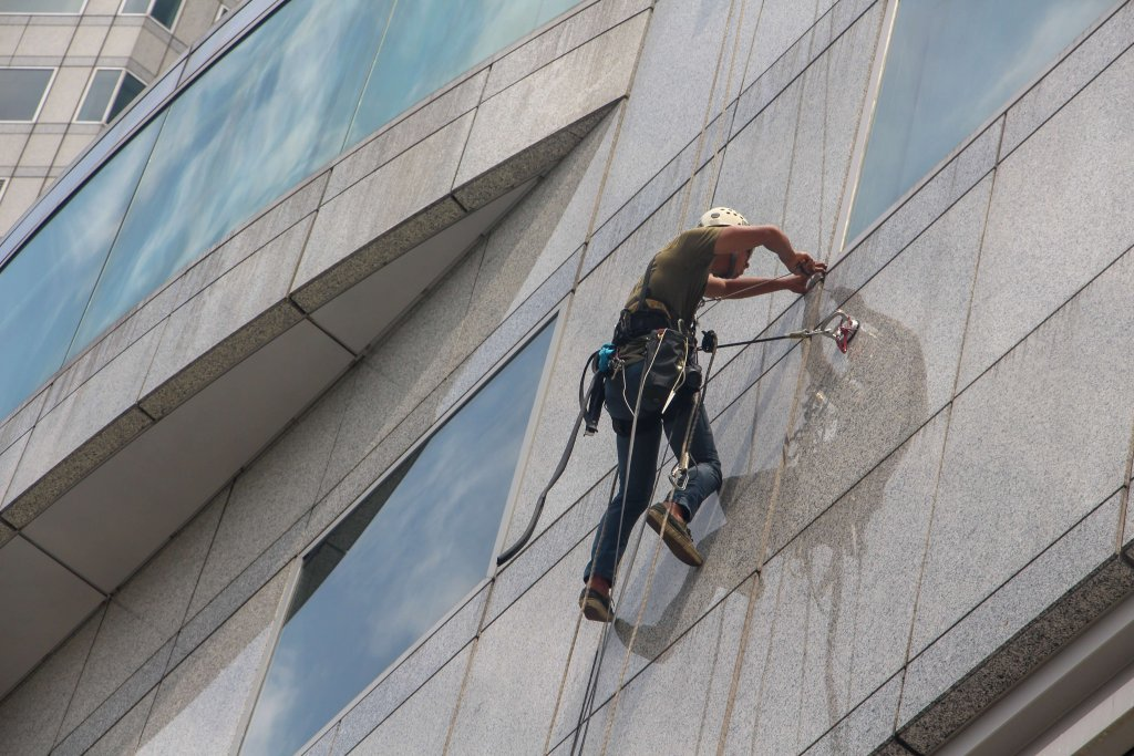 Pressure washing commercial building